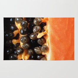Papaya fruit halved macro Rug