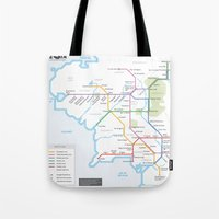 middle earth Tote Bags featuring Middle Earth Transit Map by mehmetikberker