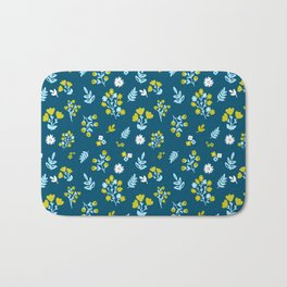 Flowers in dark blue and yellow color combination Bath Mat
