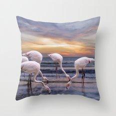 Flamingos feeding Throw Pillow
