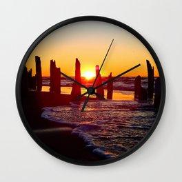 Stunning sunset through the sticks Wall Clock