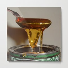 GOLDEN SYRUP DRIPPING FROM SPOON Metal Print