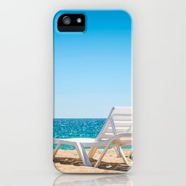 Two chaise-longues on the beach without people iPhone Case