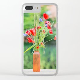 Bunch of of red poppies, cornflowers and ears of barley, wheat and rye on the table. Clear iPhone Case