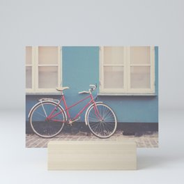 A pretty red bicycle on the streets of Copenhagen Mini Art Print