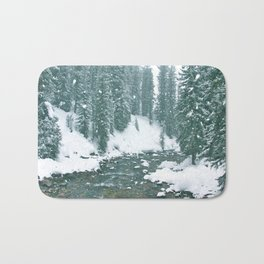 snow falling on a mountain river landscape Bath Mat