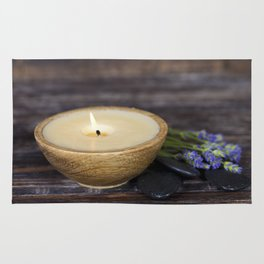 Fresh  lavender flowers, candle and  zen stones  over wooden surface Rug