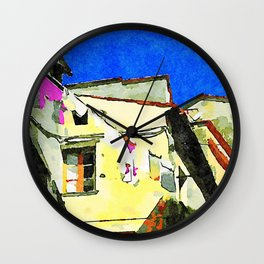 Foreshortening old town with clothes hanging Wall Clock