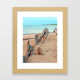 Wharf Remains on the Beach Framed Art Print