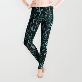 Branches with leaves on dark background Leggings