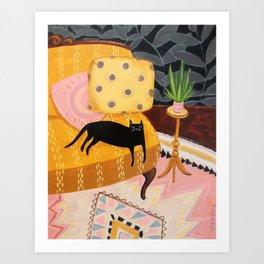 black cat on mustard yellow sofa painting by Tascha Art Print
