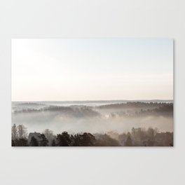 Foggy landscape with roof tops Canvas Print