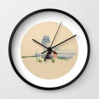 kiki Wall Clocks featuring Kiki  by lauramaahs