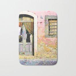 Vulture: door and window on pink wall Bath Mat