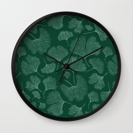 Silhouettes of ginkgo leaves on dark background Wall Clock