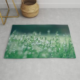 Misty view of dew on wild plants in the meadow Rug
