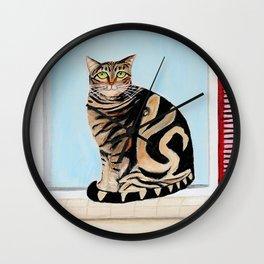 Cat sitting on window sill Wall Clock