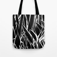 plant Tote Bags featuring plant by Baptiste Riethmann