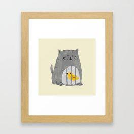 A cat that swallows a bird Framed Art Print