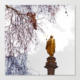 Statue of a saint in gold Canvas Print