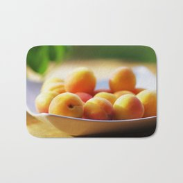 fresh apricots on the table Bath Mat