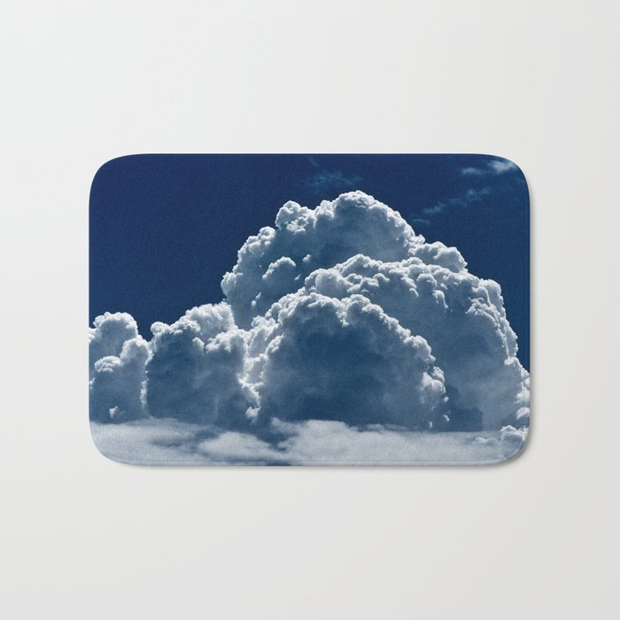 Puffy Cumulus clouds on Deep Blue Sky Bath Mat