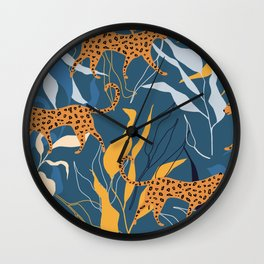 Leopard in a jungle exotic setting against dark blue Wall Clock