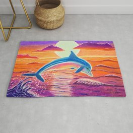 Dolphin at sunset Rug