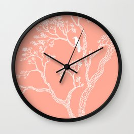 Crow in a tree peach color Wall Clock