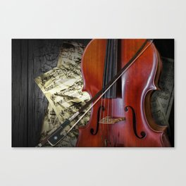 Cello with Bow a Stringed Instrument with Classical Sheet Music Canvas Print