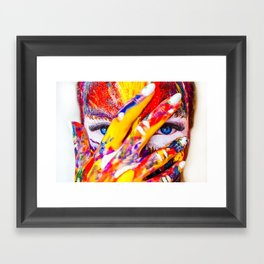 Women with paint on her hands and face Framed Art Print