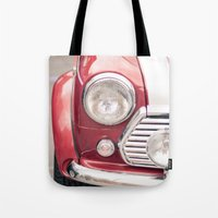mini cooper Tote Bags featuring Red Mini Cooper by Oy Photography