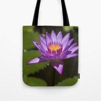 lotus flower Tote Bags featuring Lotus by Maria Heyens