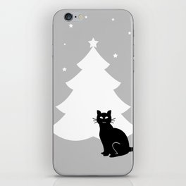 A black cat and Christmas tree iPhone Skin