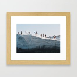 Tiny people on rocky cliff in Sarakiniko, Milos Greece Framed Art Print