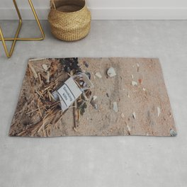 Empty Cigarette Box on the Street, A Rug