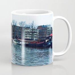 Cityscape of amsterdam on a riverside  Coffee Mug