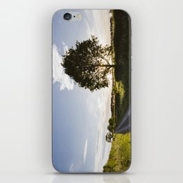 sunset over remote country lane iPhone Skin