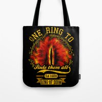 lord of the ring Tote Bags featuring Ring of doom by BomDesignz