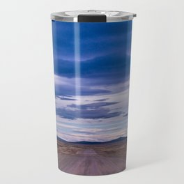 Wind and empty roads in Patagonia. Travel Mug