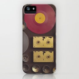Music. Vintage wall with vinyl records and audio cassettes hung. iPhone Case