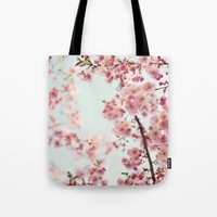 cherry blossoms Tote Bags featuring Cherry blossoms by Photography by Karin A