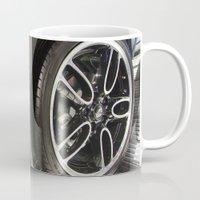 bmw Mugs featuring BMW Mini Paceman Wheel by Mauricio Santana