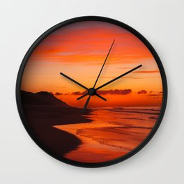 Sunset on the coast Wall Clock