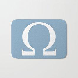 Greek letter Omega sign on placid blue background Bath Mat