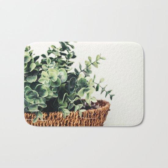 Plant On White Bath Mat