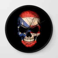 puerto rico Wall Clocks featuring Dark Skull with Flag of Puerto Rico by Jeff Bartels