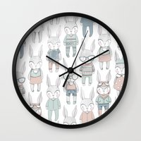 bunnies Wall Clocks featuring BUNNIES by Catalina Graphic