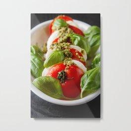 Fresh italian Caprese salad tomato and mozzarella slices with basil leaves green pesto  Metal Print