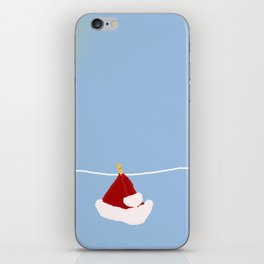 santa hat on clothesline iPhone Skin